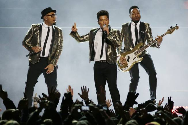 Bruno Mars performs during the Pepsi Super Bowl XLVIII Halftime Show on Sunday, Feb. 2, 2014, in East Rutherford, N.J. The Seattle Seahawks and the Denver Broncos are playing in the Super Bowl.