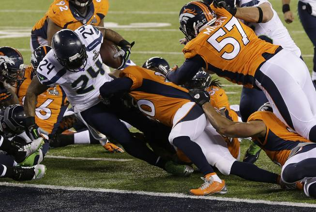 The Seattle Seahawks' Marshawn Lynch (24) runs into the end zone for a touchdown during the first half of Super Bowl XLVIII against the Denver Broncos on Sunday, Feb. 2, 2014, in East Rutherford, N.J.