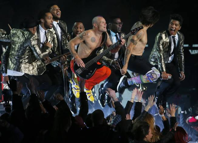 The Red Hot Chili Peppers and Bruno Mars, far right, perform during the Pepsi Super Bowl XLVIII Halftime Show on Sunday, Feb. 2, 2014, in East Rutherford, N.J. The Seattle Seahawks and the Denver Broncos are playing in the Super Bowl at MetLife Stadium.