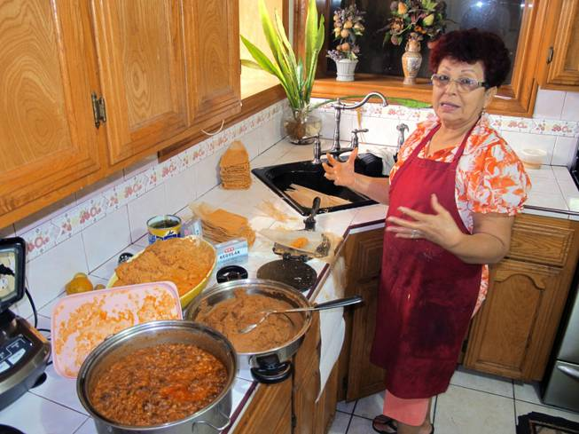 Hilda Vasquez makes tamales in her kitchen in Edinburg, Texas, on Wednesday, Dec. 4, 2013. Vasquez raised the $680 for her U.S. citizenship application by selling homemade tamales at South Texas offices.