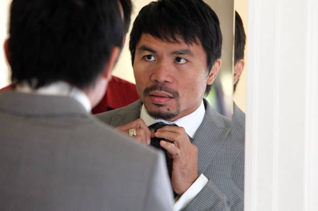 Feb.  3, 2014, Beverly Hills ,Ca.   ---  Manny Pacquiao adjusts his tie during a commercial shoot in Beverly Hills Monday for his upcoming rematch with undefeated WBO World Welterweight  champion Timothy Bradley.  Both fighters will announce their eagerly-anticipated rematch during a two-city media tour that will include press conference stops in Los Angeles on Tuesday and New York on Thursday.  Pacquiao vs. Bradley 2 will take place, Saturday, April 12 at the MGM Grand Garden Arena in Las Vegas. Chris Farina - Top Rank