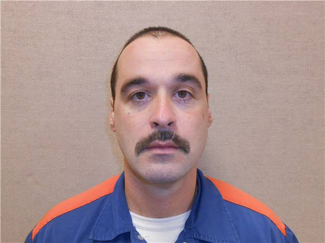 This Feb. 11, 2013, photo provided by the Michigan Department of Corrections shows Michael David Elliot. Elliot, who is serving life behind bars for murder in four 1993 deaths in Michigan, has escaped from prison and may have abducted a woman before she got away in Indiana, according to officials. Michigan Department of Corrections spokesman Russ Marlan says in an email that 40-year-old Elliot was discovered missing about 9:30 p.m. Sunday, Feb. 2, 2014, from the Ionia Correctional Facility in mid-Michigan.