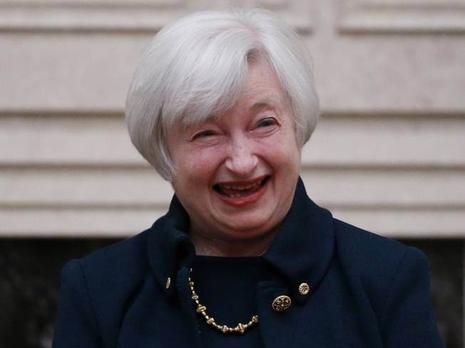 Janet Yellen reacts to applause by staff members after she was sworn in as Federal Reserve Board chair, Monday, Feb. 3, 2014, at the Federal Reserve in Washington. Yellen is the first woman to lead the Federal Reserve.