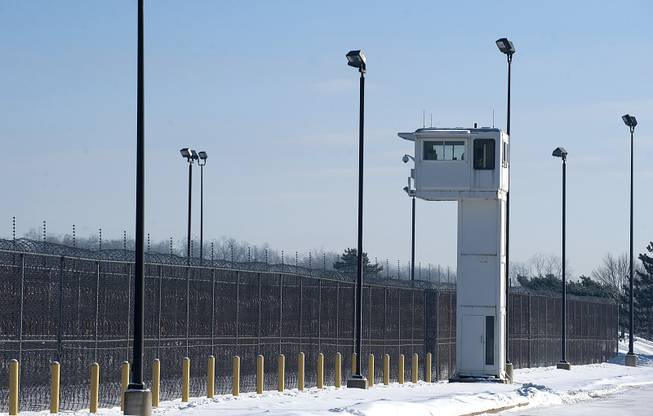 A guard tower stands over fencing at the Ionia Correctional Facility, Monday, Feb. 3, 2014. Convicted killer Michael Elliot escaped from the prison on Sunday.