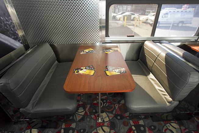 A view of a seating in a lounge car during a tour of X Train Club cars Tuesday, Feb. 4, 2014.