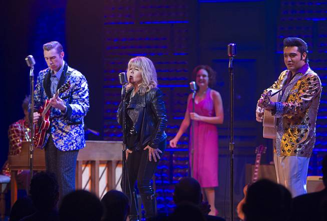 "Singer/actress Pia Zadora performs during a guest performance in ""Million Dollar Quartet"" at Harrah's Tuesday, Feb. 4, 2014. With Zadora are Scott Hinds, left, Felice Garcia, and Justin Shandor."