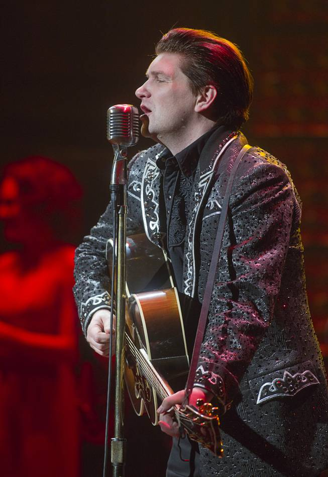 "Benjamin Hale performs as Johnny Cash in ""Million Dollar Quartet"" at Harrah's Tuesday, Feb. 4, 2014."