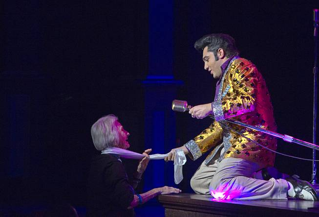 "Justin Shandor as Elvis interacts with an audience member during ""Million Dollar Quartet"" at Harrah's Tuesday, Feb. 4, 2014."