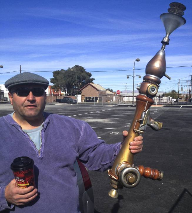 Sheet metal worker Anthony Calderone, lured by the Life Cube, shows off his the steampunk gun he fashioned from all sorts of discarded items of various shapes and sizes Tuesday, Feb. 4, 2014.