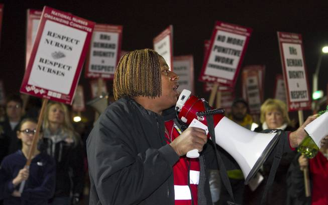 National Nurses United Representative Leslie Curtis pumps up the RNs and supporters picketing outside the St. Rose Dominican Hospital - Siena in Henderson, NV Tuesday, Feb. 4, 2014.