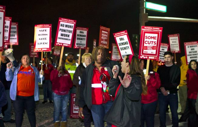 St. Rose Dominican Hospital RN Elizabeth Bickle speaks alongside the National Nurses United Representative Leslie Curtis to motivate the RNs and supporters picketing outside the hospital in Henderson Tuesday, Feb. 4, 2014.