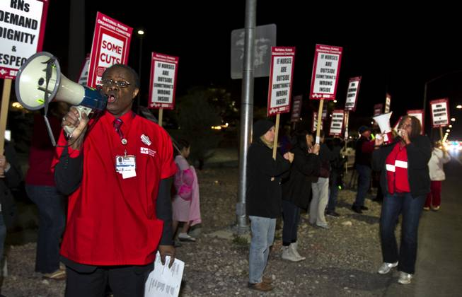 St. Rose Dominican Hospital-Siena RN Orsburn Stone, left, leads a chant during a RN and supporters picketing rally outside the hospital in Henderson on Tuesday, Feb. 4, 2014.