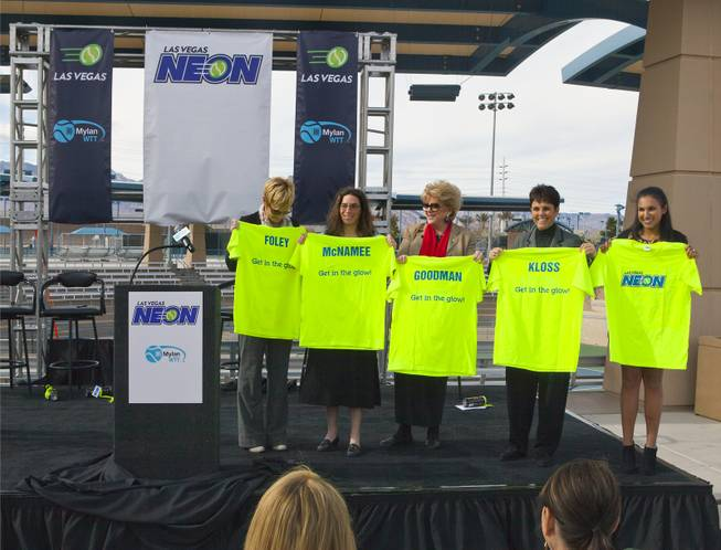(center) Las Vegas Mayor Carolyn G. Goodman joins others on stage with custom t-shirts following a press conference at the Darling Tennis Center to announce the Las Vegas Neon of the Mylan World Team Tennis on Tuesday, Feb. 04, 2014.