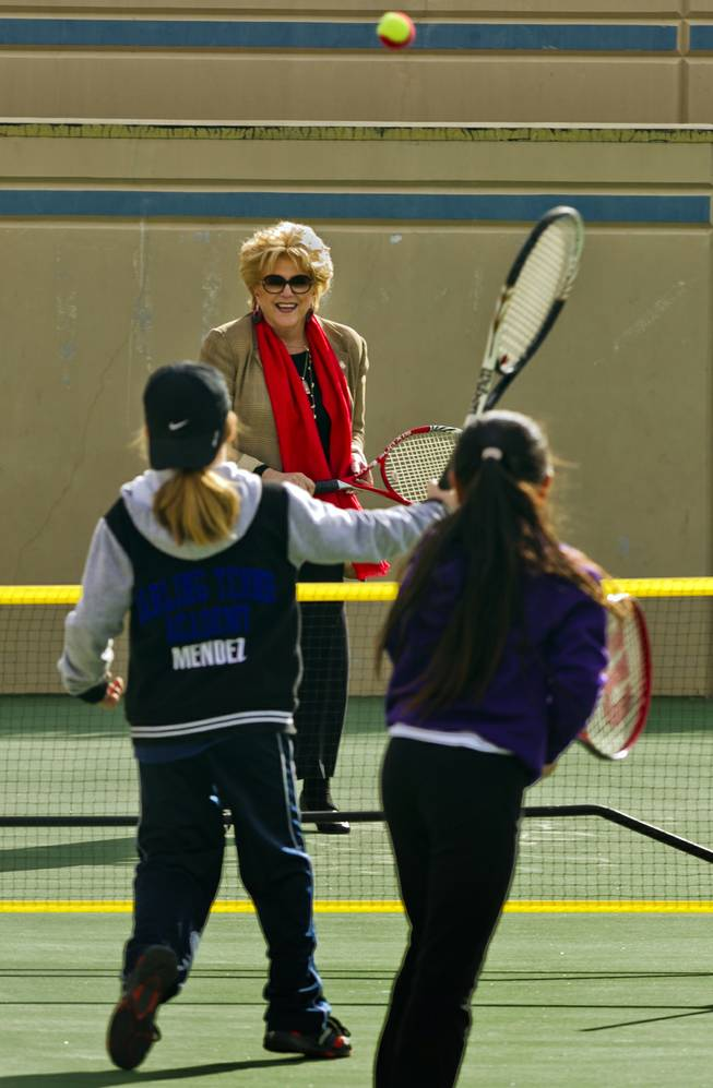 (from back) Las Vegas Mayor Carolyn G. Goodman joins Rocci Mendez, 8, and Natalie Cheong, 9, in a few volleys at the Darling Tennis Center on Tuesday, Feb. 04, 2014.  The mayor was on hand to announce the arrival of the Las Vegas Neon of the Mylan World Team Tennis here.