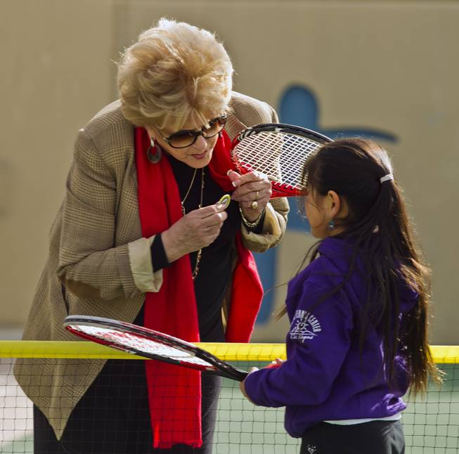 Las Vegas Mayor Carolyn G. Goodman presents Natalie Cheong, 9, with her token after a few volleys at the Darling Tennis Center on Tuesday, Feb. 04, 2014.  The mayor was on hand to announce the arrival of the Las Vegas Neon of the Mylan World Team Tennis here.