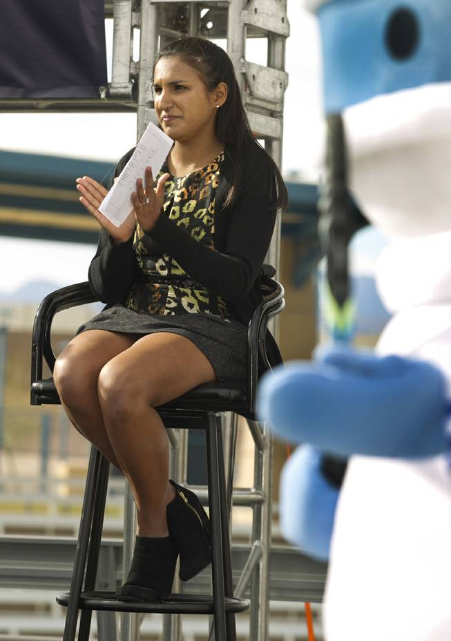 Sarah Wannakuwatte applauds during press conference at the Darling Tennis Center to announce the Las Vegas Neon of the Mylan World Team Tennis on Tuesday, Feb. 04, 2014. She is the Neon team owner's daughter.