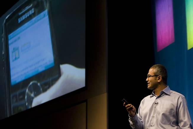 Microsoft Senior Vice President of Portal and Advertising Platform Group Satya Nadella demonstrates some of the features of Live Search on a mobile device during the advance08 Advertising Leadership Forum at the company's campus in Redmond, Wash., Wednesday May 21, 2008.
