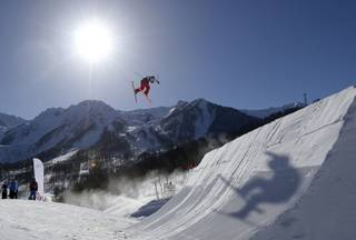 A competitor takes a jump during a ski slopestyle training session at the Rosa Khutor Extreme Park, prior to the 2014 Winter Olympics, Tuesday, Feb. 4, 2014, in Krasnaya Polyana, Russia.