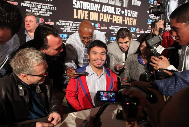 Feb.  4, 2014, Beverly Hills ,Ca.   ---   Manny Pacquiao talks to reporters during the press conference  in Beverly Hills to announce his upcoming rematch against undefeated WBO World Welterweight  champion Timothy Bradley during a two-city media tour in Los Angeles on Tuesday and New York on Thursday.  Pacquiao vs. Bradley 2 will take place, Saturday, April 12 at the MGM Grand Garden Arena in Las Vegas. Chris Farina - Top Rank