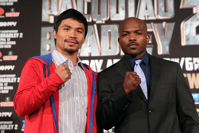 Feb.  4, 2014, Beverly Hills ,Ca.   ---  Manny Pacquiao, left, and undefeated WBO World Welterweight  champion Timothy Bradley pose during the press conference  in Beverly Hills to announce their upcoming rematch during a two-city media tour in Los Angeles on Tuesday and New York on Thursday.  Pacquiao vs. Bradley 2 will take place, Saturday, April 12 at the MGM Grand Garden Arena in Las Vegas. Chris Farina - Top Rank