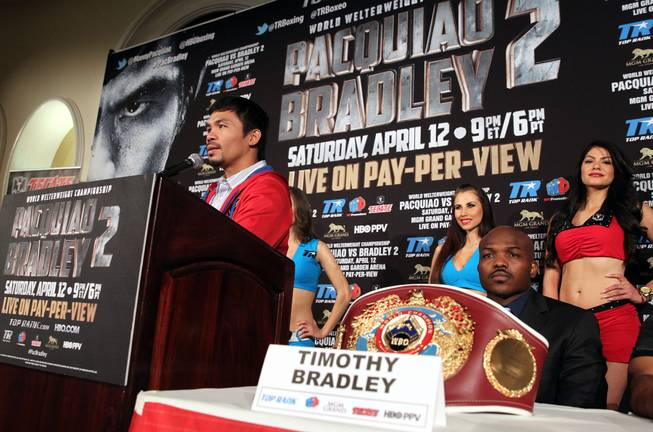 Feb.  4, 2014, Beverly Hills ,Ca.   ---  Manny Pacquiao (L) and undefeated WBO World Welterweight  champion Timothy Bradley(R) attend the press conference  in Beverly Hills to announce their upcoming rematch during a two-city media tour in Los Angeles on Tuesday and New York on Thursday.  Pacquiao vs. Bradley 2 will take place, Saturday, April 12 at the MGM Grand Garden Arena in Las Vegas. Chris Farina - Top Rank