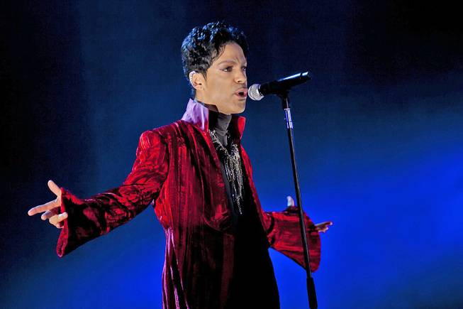 "Musician Prince performs at the Sziget Festival on the Shipyard Island, northern Budapest, Hungary, Aug. 9, 2011. The enigmatic star flew into London on Feb. 4, 2014, at the start of a still-evolving string of dates in support of forthcoming album ""Plectrum Electrum."""