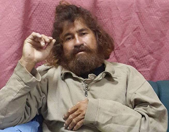 In this Monday, Feb. 3, 2014, photo provided by the Marshall Islands Foreign Affairs Department, a man identifying himself as 37-year-old Jose Salvador Alvarenga sits on a couch in Majuro in the Marshall Islands, after he was rescued from being washed ashore on the tiny atoll of Ebon in the Pacific Ocean.