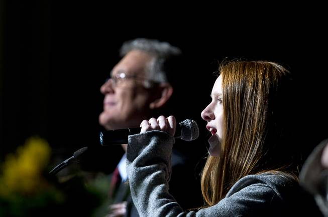 Jessica Banek, 13, signs the national anthem during the State of the City address at Green Valley Ranch Wednesday, Feb. 5, 2014.
