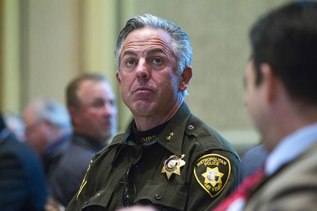 Metro Assistant Sheriff Joe Lombardo listens to  Henderson Mayor Andy Hafen during the State of the City address at Green Valley Ranch Wednesday, Feb. 5, 2014.