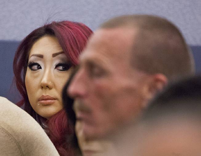 Gloria Lee, accused of arson and animal cruelty, in connection with a fire at her pet store, Prince and Princess Pet Boutique, appears in court Wednesday, Feb. 5, 2014.