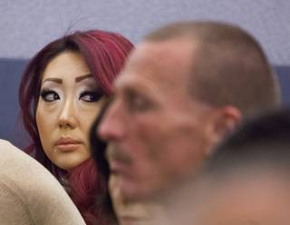 Gloria Lee, accused of arson and animal cruelty in connection with a fire at her pet store, Prince and Princess Pet Boutique, appears in court Wednesday, Feb. 5, 2014.