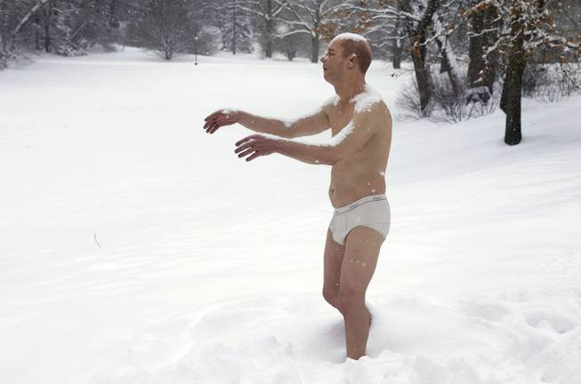 "A statue of a man sleepwalking in his underpants is surrounded by snow on the campus of Wellesley College, in Wellesley, Mass., Wednesday, Feb. 5, 2014. The sculpture entitled ""Sleepwalker"" is part of an exhibit by sculptor Tony Matelli at the college's Davis Museum."