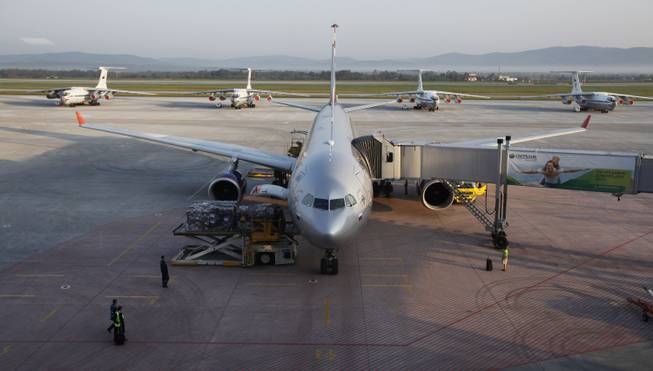 An Aeroflot Airbus parks in front of older Russian-made planes at the terminal in Vladivostok airport in Vladivostok, Russia, Tuesday, Sept. 11, 2012.