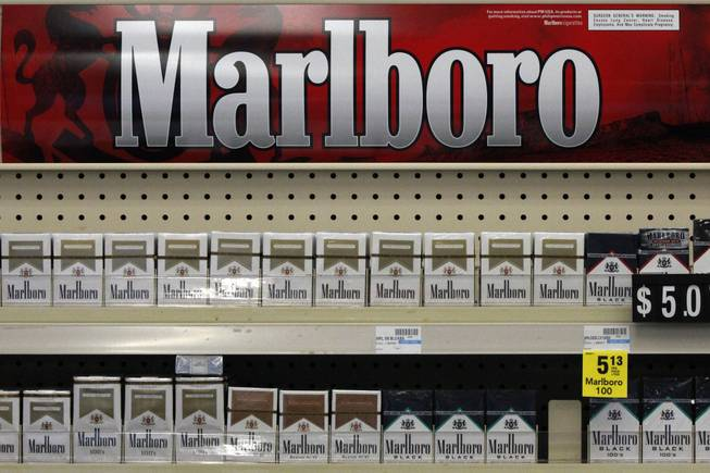 In this Wednesday, July 17, 2013, file photo, Marlboro cigarettes are on display in a CVS store in Pittsburgh. The nation's second-largest drugstore chain says it will phase out cigarettes, cigars and chewing tobacco by Oct. 1 as it continues to focus more on health care.