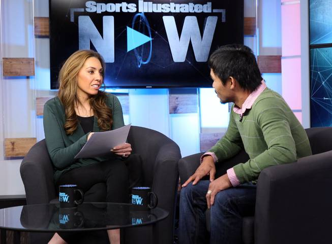 "Feb.  5, 2014, New York,NY   ---  ""MAKIN' THE ROUNDS"" ---  Manny Pacquiao(R) talks with Maggie Gray(L), host of  ""SI Now"" during a taping at the Sports Illustrated offices in New York City Wednesday. Pacquiao is on the second stop of a two-city media tour to announce his upcoming rematch against undefeated WBO World Welterweight  champion Timothy Bradley. Pacquiao vs. Bradley 2 will take place, Saturday, April 12 at the MGM Grand Garden Arena in Las Vegas. Chris Farina - Top Rank"