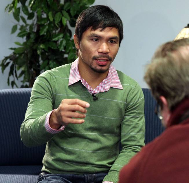 "Feb.  5, 2014, New York,NY   ---  ""MAKIN' THE ROUNDS"" ---  Manny Pacquiao sits down for an interview at Associated Press in New York City Wednesday. Pacquiao is on the second stop of a two-city media tour to announce his upcoming rematch against undefeated WBO World Welterweight  champion Timothy Bradley. Pacquiao vs. Bradley 2 will take place, Saturday, April 12 at the MGM Grand Garden Arena in Las Vegas. Chris Farina - Top Rank"