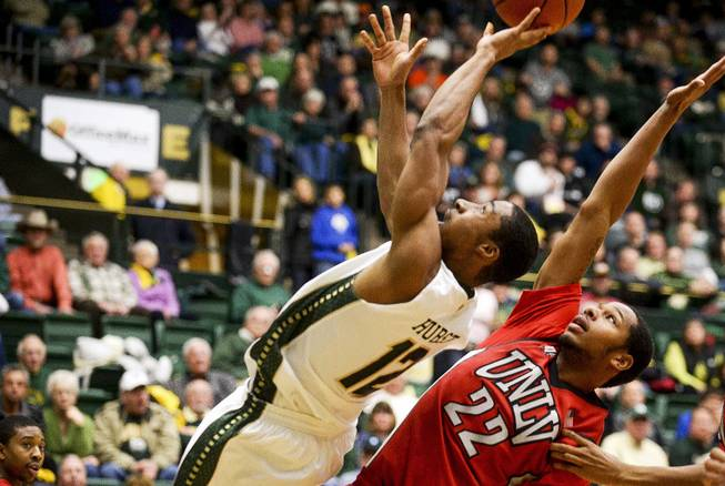 Colorado State's Carlton Hurst shoots as he's fouled by UNLV's Jelan Kendrick (22) on Wednesday, Feb. 5, 2014, at Moby Arena in Fort Collins, Colo. Colorado State won 75-57.