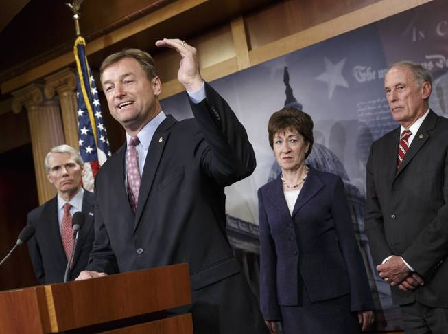 Sen. Dean Heller, R-Nev., second from left, accompanied by fellow Senate Republicans, gestures during a news conference on Capitol Hill in Washington, Tuesday, Jan. 14, 2014, where they discussed benefits to long-term jobless workers. From left are Sen. Rob Portman, R-Ohio, Heller, Sen. Susan Collins, R-Maine, and Sen. Dan Coats, R-Ind.