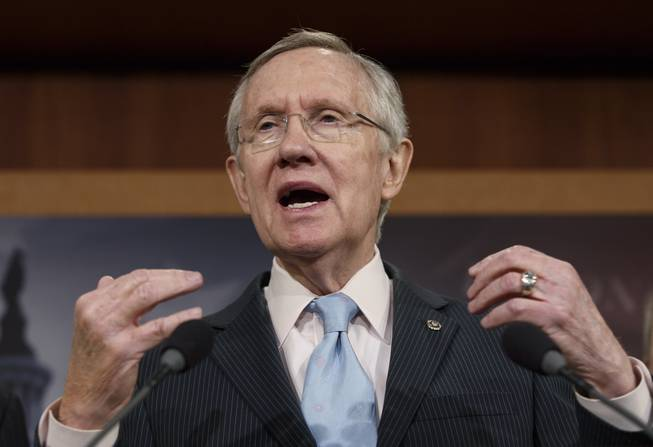 Senate Majority Leader Harry Reid, D-Nev., tells reporters that Republicans are thwarting Democratic efforts pass a bill to extend unemployment benefits which expired at the end of last year, at the Capitol in Washington, Thursday, Feb. 6, 2014.