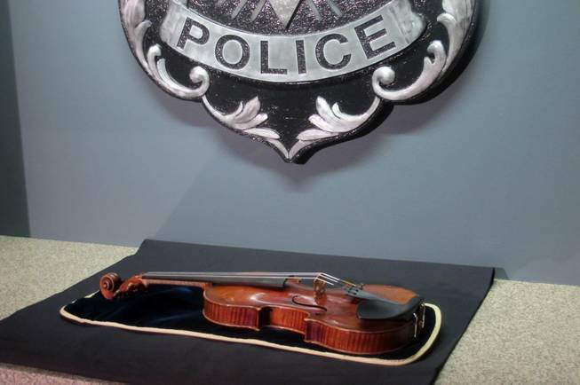 A $5 million Stradivarius violin is displayed at the Milwaukee Police Department Thursday, Feb. 6, 2014, in Milwaukee, a day after police recovered the instrument, which was stolen on Jan. 27 from a concertmaster in a parking lot by a person wielding a stun gun.