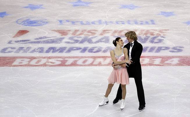 Meryl Davis and Charlie White skate during the ice dance short program at the U.S. Figure Skating Championships in Boston, Friday, Jan. 10, 2014.