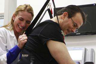 Physical therapist Jen Nash and Kerry Simon laugh while Simon works on a treadmill during a therapy session at the Cleveland Clinic Lou Ruvo Center for Brain Health on Friday, Feb. 7, 2014.