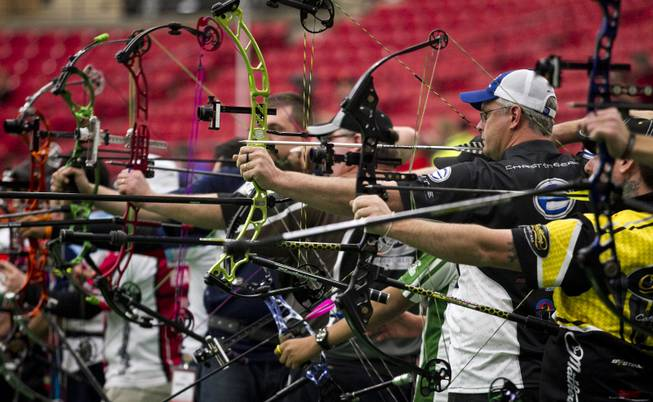 Archers launch arrows during the Adult Freestyle Championship in the South Point Arena as part of the Vegas Round of the 2014 NFAA World Archery Festival on Friday, Feb. 7, 2014.