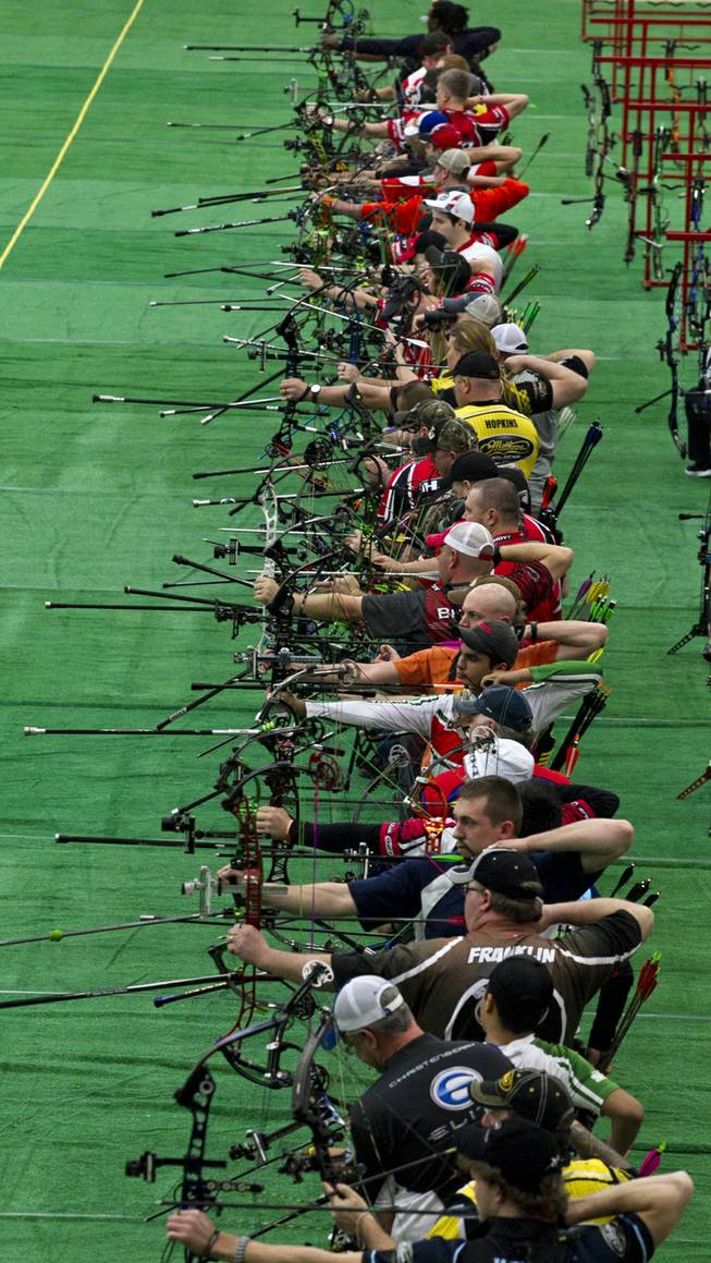 Competitors launch arrows during the Adult Freestyle Championship in the South Point Arena as part of the Vegas Round of the 2014 NFAA World Archery Festival on Friday, Feb. 7, 2014.