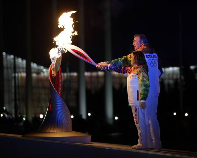 Irina Rodnina and Vladislav Tretiak light the Olympic cauldron during the opening ceremony of the 2014 Winter Olympics in Sochi, Russia, Friday, Feb. 7, 2014.