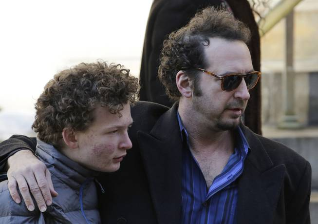 David Bar Katz, right, a friend of actor Philip Seymour Hoffman, arrives for the actor's funeral at the Church of St. Ignatius Loyola, Friday, Feb. 7, 2014 in New York. Hoffman, 46, was found dead Sunday of an apparent heroin overdose.
