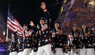 The U.S. team arrives during the opening ceremony of the 2014 Winter Olympics in Sochi, Russia, on Friday, Feb. 7, 2014.