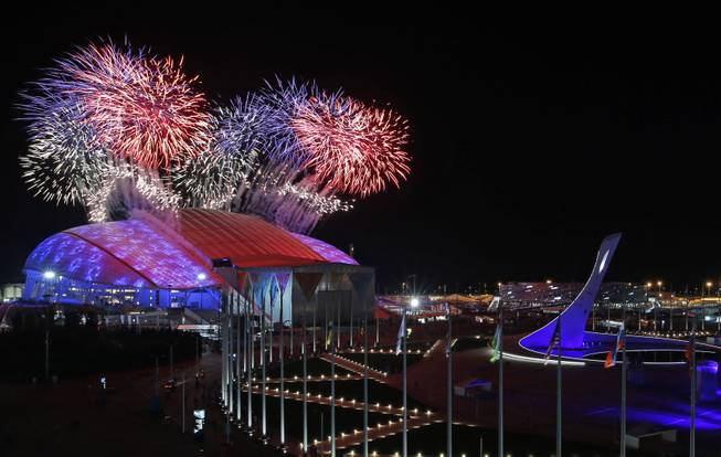 Fireworks are seen over Olympic Park during the opening ceremony of the 2014 Winter Olympics in Sochi, Russia, Friday, Feb. 7, 2014.