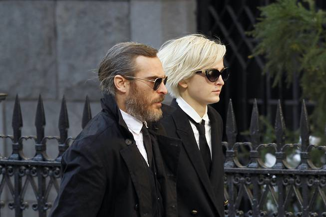 Actor Joaquin Phoenix arrives at the Church of St. Ignatius Loyola for the private funeral of actor Philip Seymour Hoffman Friday, Feb. 7, 2014, in New York. Hoffman, 46, was found dead Sunday of an apparent heroin overdose.