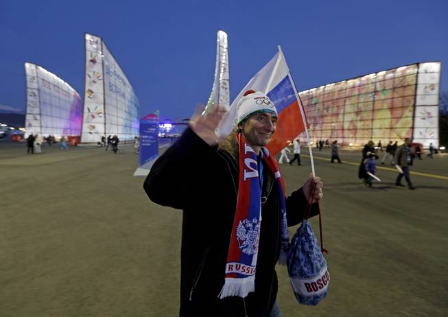Fans make their way to Fisht Stadium for the opening ceremony of the 2014 Winter Olympics in Sochi, Russia, Friday, Feb. 7, 2014.
